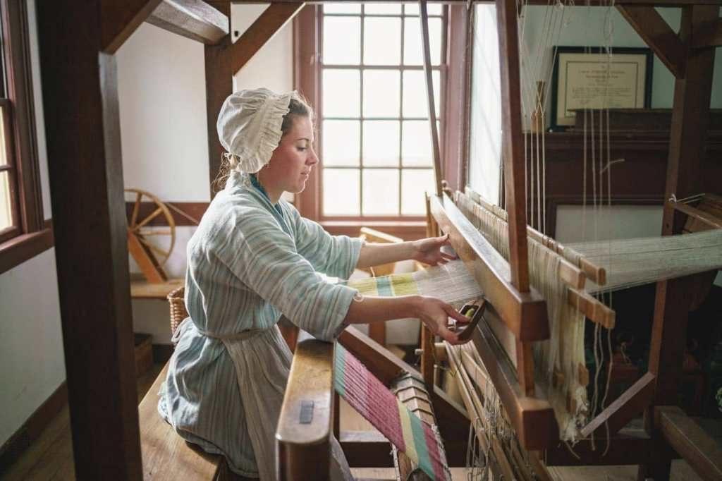 weaver using cotton loom